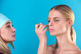 cosmetic-surgeon-examining-female-client-office-doctor_cg2p77563034c_th